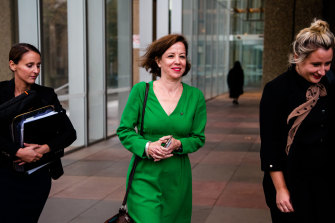 Jo Dyer, centre, outside the Federal Court in Sydney on Tuesday.