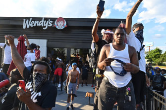 Protesters demonstrate outside a Wendy's restaurant in Atlanta where Rayshard Brooks, a black man, was shot and killed by Atlanta police on Friday evening following a struggle in the drive-thru line.