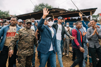 Ethiopian Prime Minister Abiy Ahmed walks to a polling location to cast his vote in the country's national election at his home town of Beshasha.