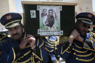 Honor guards carry coffins adorned with photographs of Houthi rebel fighters who who were killed in recent fighting with forces of Yemen's Saudi-backed internationally recognised government during their funeral procession, in Sanaa last month.