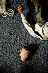 A headless doll of Adolf Hitler in Mark Hogancamp's home in Kingston, New York.