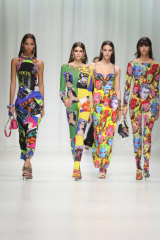 Models wear Versace's Tribute Collection, printed with Vogue magazine covers and portraits of James Dean and Marilyn Monroe.