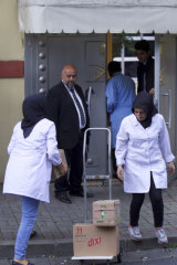 Cleaning personnel enter Saudi Arabia's Consulate in Istanbul.