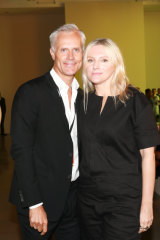 Malcolm Carfrae with 'InStyle' editor Laura Brown at Zimmermann's show at New York Fashion Week in September 2017.