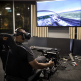 Lockheed Martin Australia systems integrator, Vikas Nayak, demonstrating the virtual technology in Canberra.