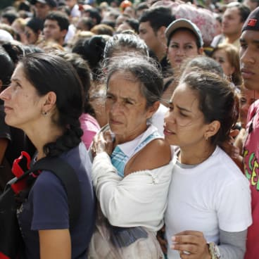 Venezuelans wait in line to cross into Colombia through the Simon Bolivar bridge in San Antonio del Tachira in 2016 at the start of the exodus.