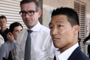 Liberals' bus stops in at Chinatown as 'racist' furore engulfs Labor
