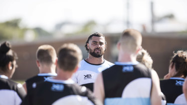Hair apparent: Andrew Fifita sports his new look at Cronulla training.