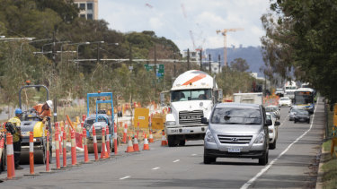 Workers reseal the turning lane from Northbourne Avenue onto Morphett Street.