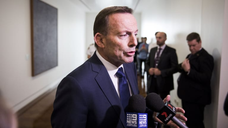 Tony Abbott leaves they party room after Friday's leadership spill.