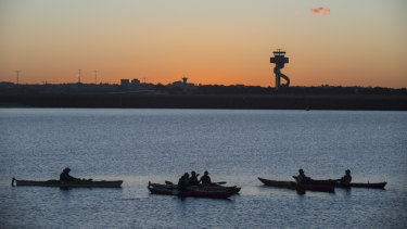 Kayakers enjoy a break at the mouth of the Cooks River at Botany Bay.