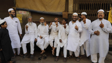 Indian Muslims display indelible ink marks on their fingers after casting their votes in Varanasi, India.