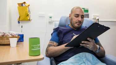 Alex Giraldo, 37, sits in the recovery room after getting a vasectomy at Marie Stopes in Westmead in Sydney.
