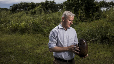 Nationals leader Michael McCormack with the party's official wooden wombat, on the campaign trail in Mackay.