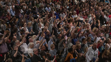 Delegates vote on a motion at the Labour annual conference in Brighton on Monday.