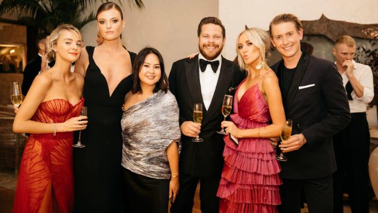 Nadia Fairfax, Montana Cox, Caroline Tran, Nick Pitt, Montarna Pitt and Elliot Garnaut raise a glass at the White Caravan gala.