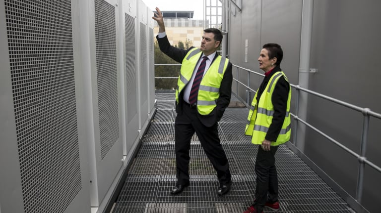 CEO of Transgrid, Paul Italiano, shows lord mayor Clover Moore the new Tesla Battery installed at the Alexandra Canal Depot.
