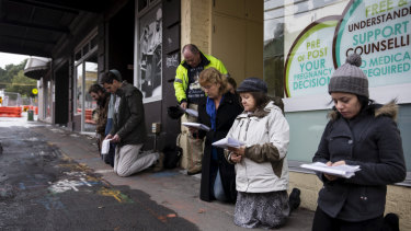 People pray outside an abortion clinic in Surry Hills.