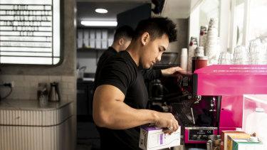Barista Bayu Gunawan making a macadamia latte.