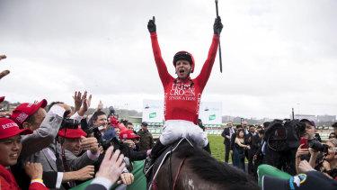 Jockey Kerrin McEvoy smiles after riding Redzel to win the TAB Everest horse race