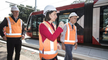 Premier Gladys Berejiklian and Transport Minister Andrew Constance, right, are hopeful that the line will be opened by the end of next year.