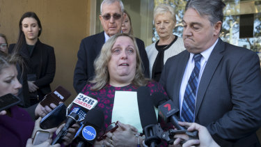 Courtney Topic's parents Leesa and Ron speak to the media outside court on Monday.