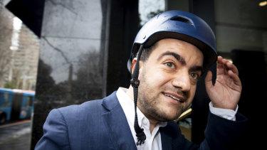 Sam Dastyari arrives at ICAC on a lime bike