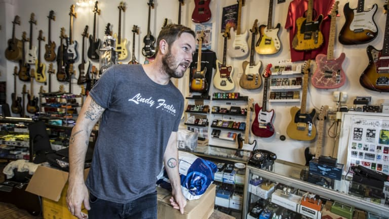 Nicholas Munning works at Global Vintage, a guitar shop on busy Parramatta Road in Annandale.
