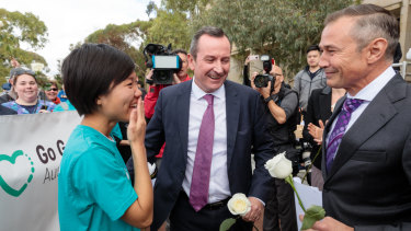 Belinda Teh is greeted by Premier Mark McGowan and Health Minister Roger Cook outside WA Parliament House. The 27-year-old Perth woman embarked on a 4500km journey from Melbourne to Perth after watching her mother die from breast cancer in 2016.