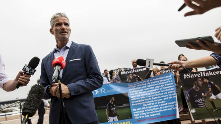 Former Socceroos star Craig Foster with demonstrators urging Thailand to release Hakeem al-Araibi, a Melbourne refugee and football player.