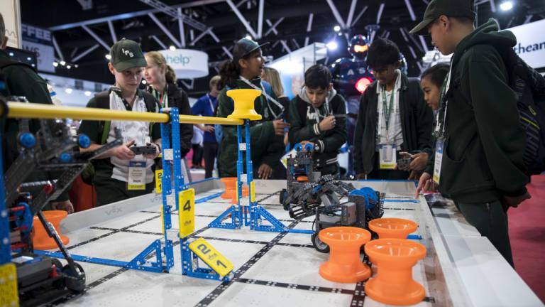 Students test out the robots at a Vex Robotics showcase at EduTECH on Thursday.