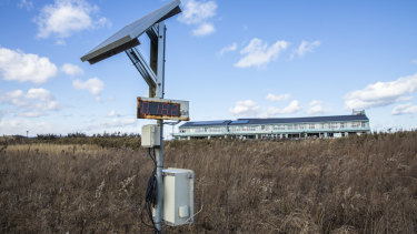 A radiation-monitoring device stands in front of Ukedo Elementary School in Namie.
