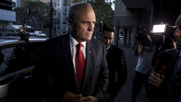 Outgoing NAB Chairman Ken Henry arrives at the ABC in Sydney for an interview on 7.30.