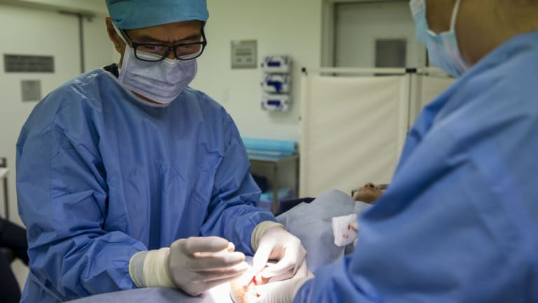 Dr Justin Low performing a vasectomy.