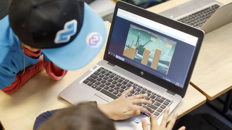 Code campers learn block and line coding to design their own computer games and iPhone apps.