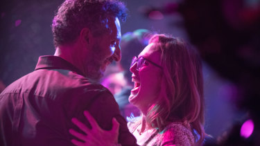 Julianne Moore dances with Arnold, an adventure park owner played by John Turturro in Gloria Bell.