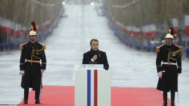 French President Emmanuel Macron delivers his Remembrance Day speech in the shadow of the Arc de Triomphe in  Paris on Sunday.