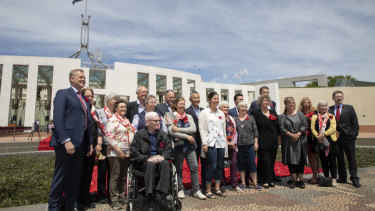 Dignitaries with volunteers who helped to install the magnificent display, even working through Wednesday's rain.
