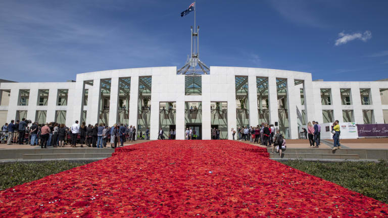 The approximately 270,000 poppies on the forecourt at Parliament House  have been handmade by men, women and children across Australia and overseas, as a tribute to Australians who have served in wars, conflicts and peace-keeping operations.