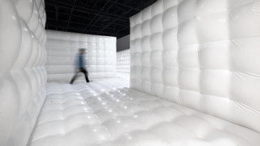 Inside the Rorschach asylum, a gigantic all-white jumping castle.