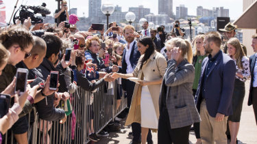 The Duke and Duchess Harry and Meghan meet the crowd outside the Opera House.