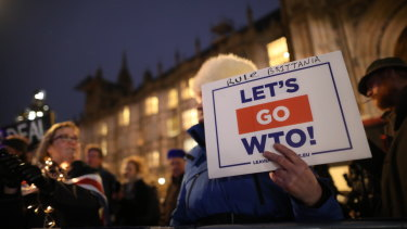 A pro-Brexit demonstrator holds a sign during the vote on a No-Deal Brexit outside Parliament on Wednesday.