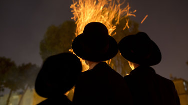 "Ultra-Orthodox Jews gather next to bonfires during the Jewish holiday of Lag Ba'Omer celebration in Israel last week. Avigdor Lieberman accused Netanyahu of ""capitulating to the ultra-Orthodox."""