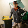 George Dahoud standing in what was the recycling room on his floor of a public housing tower in Collingwood.