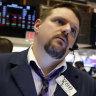 Trader Michael Milano works on the floor of the New York Stock Exchange, where stocks opened sharply lower on Thursday.