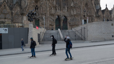 Skaters ride on the first day of the coronavirus pandemic lockdown in Barcelona in March 2020.