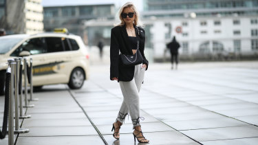 A blazer, fancy shoes and trackpants equals instant 'biz-leisure' dressing.
