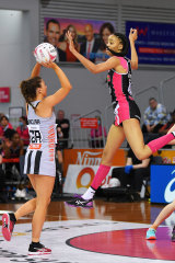 Thunderbirds are go: Shamera Sterling attempts a spectacular block as Gabrielle Sinclair of the Magpies gets set for a shot.