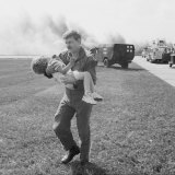 Spencer Bailey is carried after the 1989 crash-landing of United Flight 232 in Sioux City, Iowa.