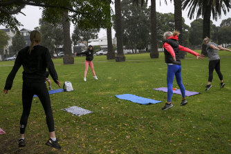 Personal trainer Keighly Collins of Sweat With Soul Fitness with her class in Port Melbourne on Wednesday.